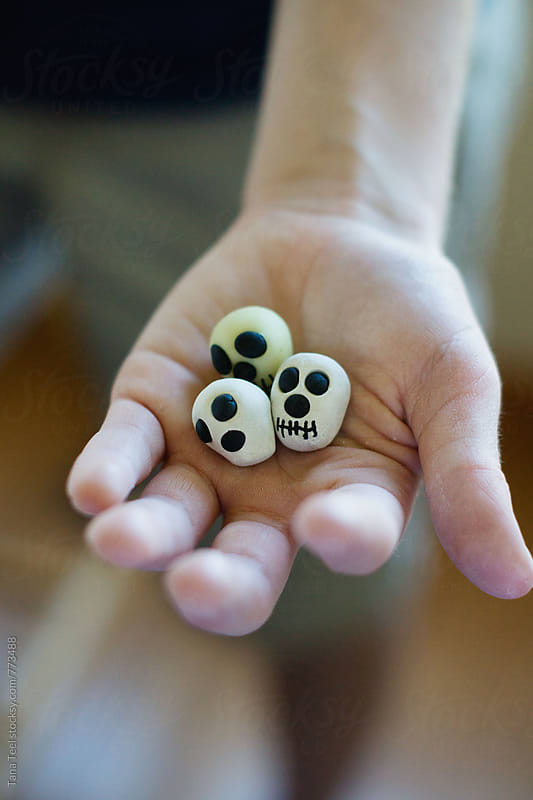 Handmade miniature modeling clay skulls by Tana Teel for Stocksy United