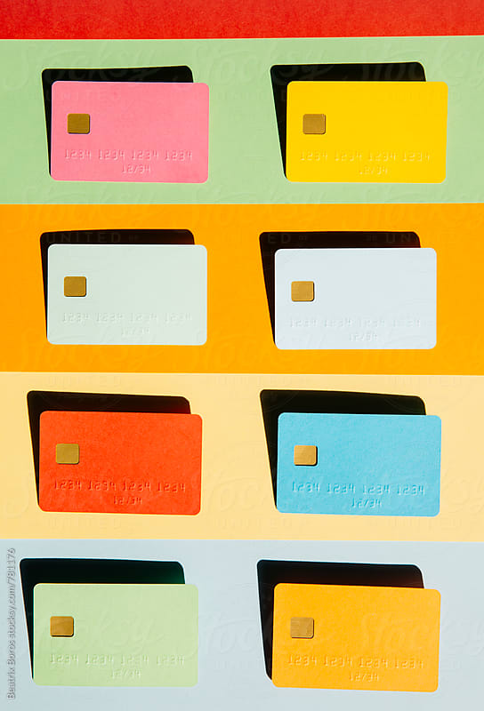 Eight blank credit cards on striped background by Beatrix Boros for Stocksy United