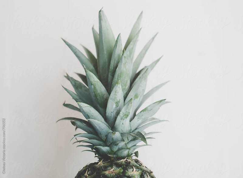 A pineapple on a white background by Chelsea Victoria for Stocksy United