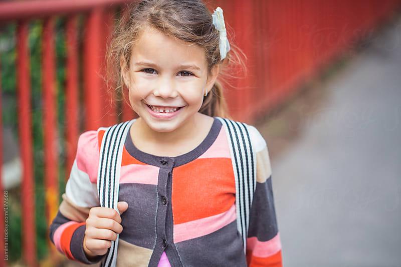 Smiling Schoolgirl by Lumina for Stocksy United