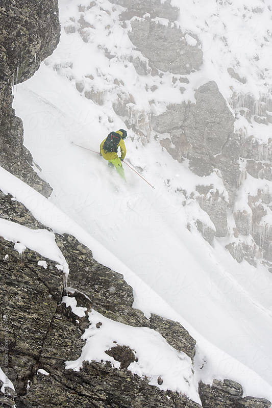 Skier on a steep snow couloir by RG&B Images for Stocksy United
