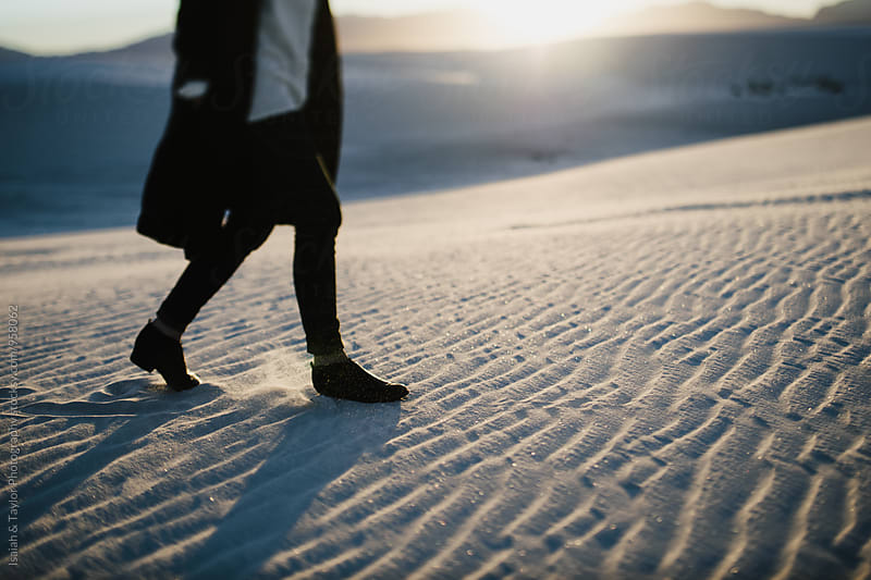 Feet walking through desert sand by Isaiah & Taylor Photography for Stocksy United