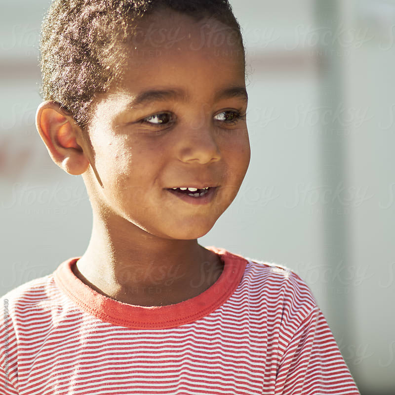 Cute black kid outdoors at sunset by Per Swantesson for Stocksy United