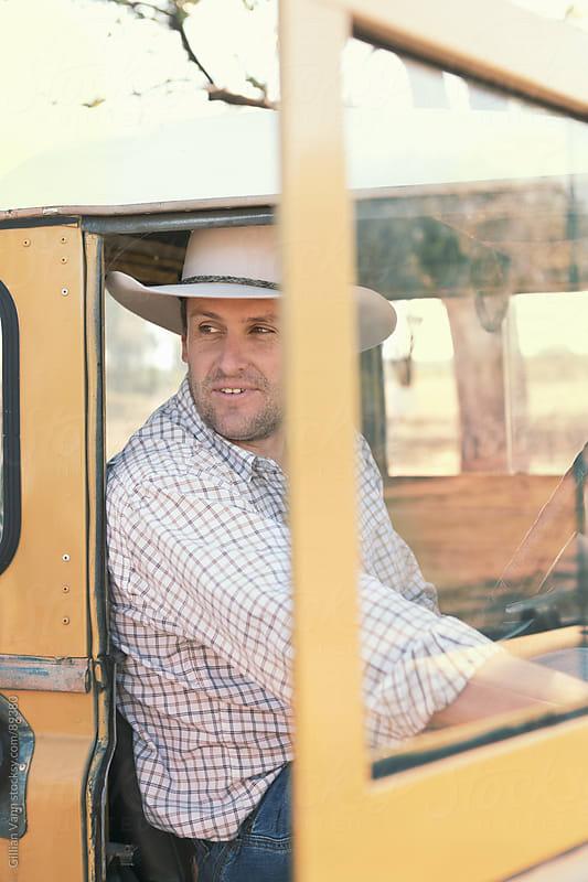 farmer in his truck by Gillian Vann for Stocksy United