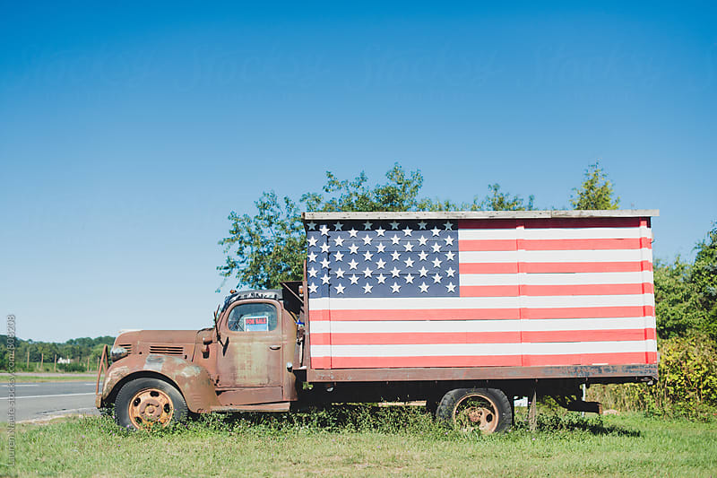 Abandoned truck with american flag by Lauren Naefe for Stocksy United