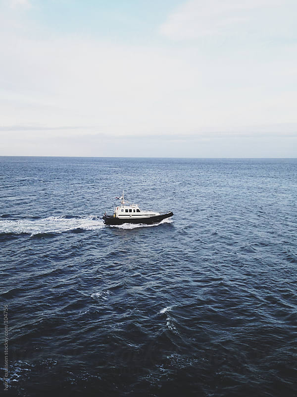 Coastguard rescue boat on open sea by Ivar Teunissen for Stocksy United