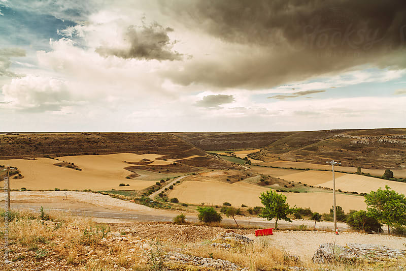 landscape with roads and cloudy sky by Javier Pardina for Stocksy United
