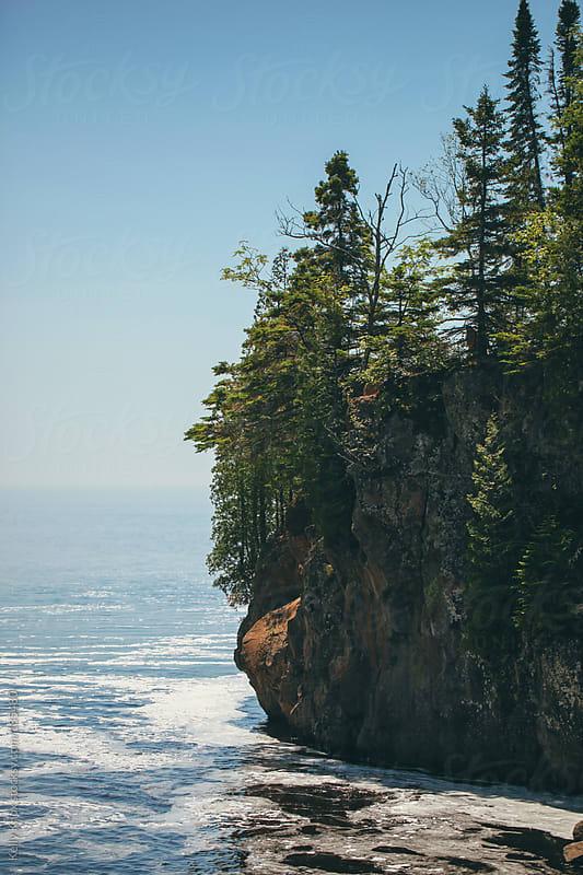 rocky shore along Lake Superior by Kelly Knox for Stocksy United