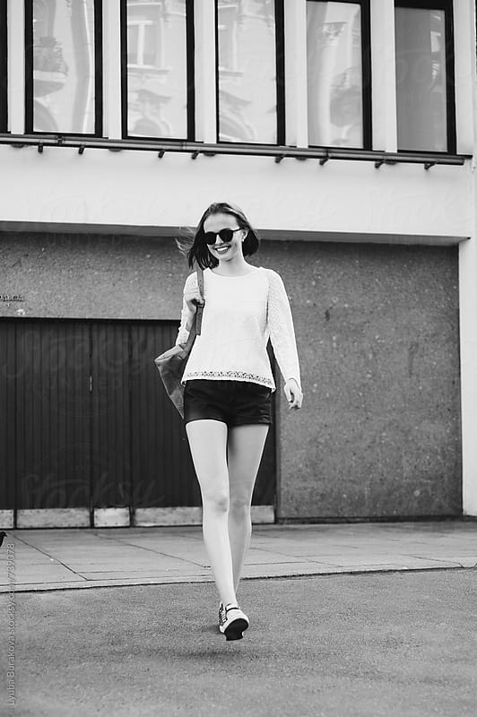 Young woman walking straight to camera by Lyuba Burakova for Stocksy United