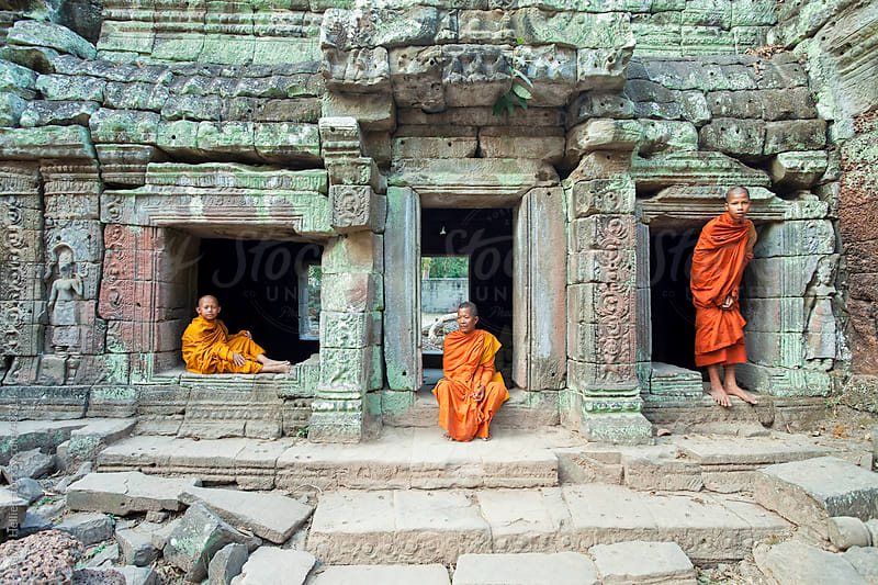 Monks in the Ta Prohm Temple, Angkor, UNESCO World Heritage Site, Siem Reap, Cambodia, Indochina, Asia by Gavin Hellier for Stocksy United