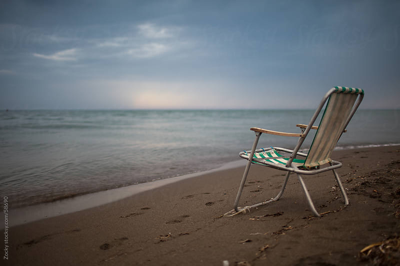 Old Lounge chair on the beach by Zocky for Stocksy United