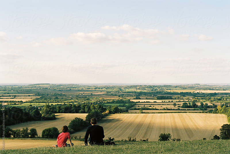 Father and son enjoying the view from Dragon Hill, Oxfordshire by Kirstin Mckee for Stocksy United