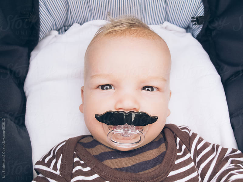 Baby with moustache pacifier by Urs Siedentop & Co for Stocksy United