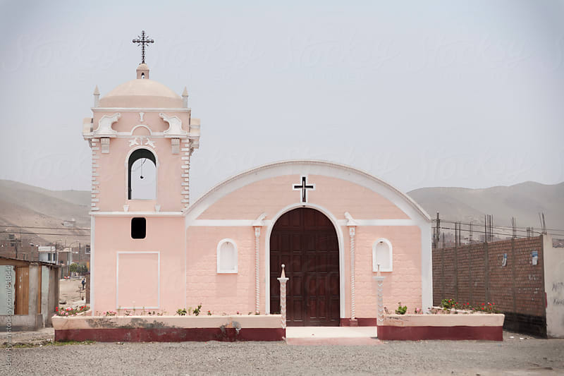 Pink modest hispanic catholic church by Ben Ryan for Stocksy United