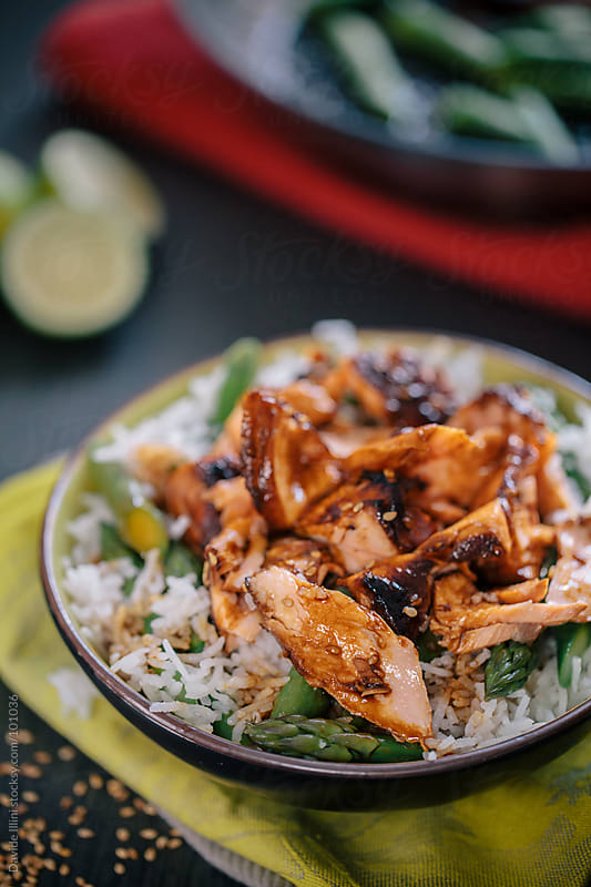 Basmati rice with asparagus and salmon teriyaki by Davide Illini for Stocksy United
