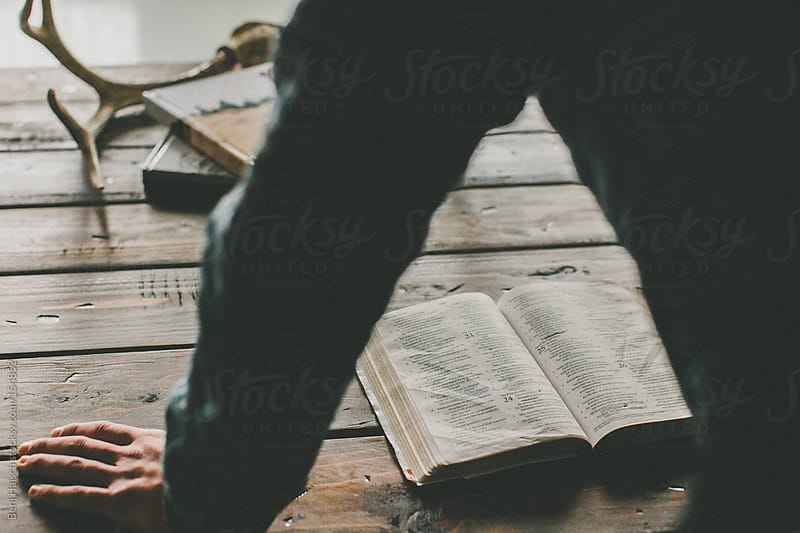Man reading bible. by Benj Haisch for Stocksy United