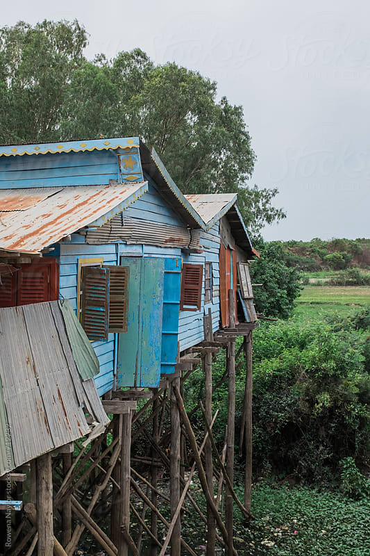 Stilt Houses in Cambodian Village by Rowena Naylor for Stocksy United