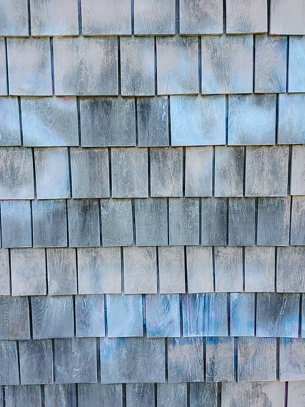 Painted blue and grey shingles on building wall, close up by Paul Edmondson for Stocksy United