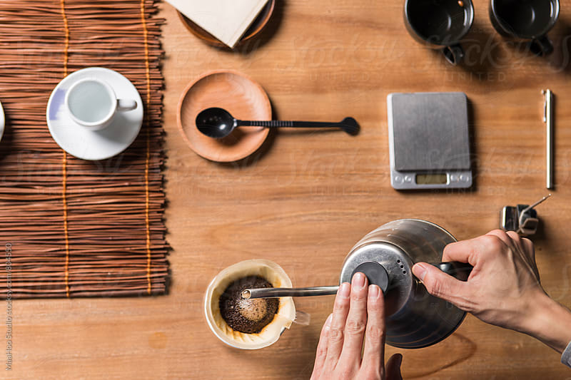 Man preparing Steaming Filter Coffee by Maa Hoo for Stocksy United