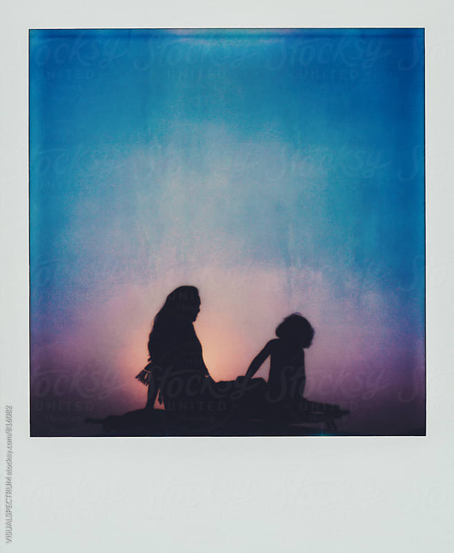 Polaroid of Mother and Child Sitting on Camper Van Roof by Julien L. Balmer for Stocksy United