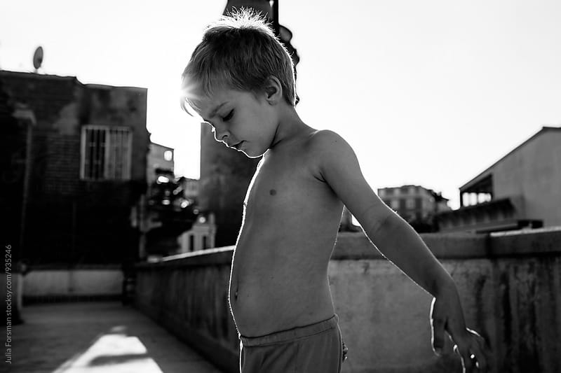 Boy playing on an Istanbul rooftop in summer. by Julia Forsman for Stocksy United