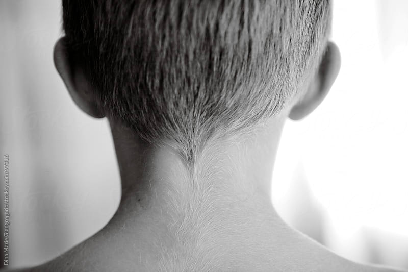 Back of boys head showing nape of neck and hairline by Dina Giangregorio for Stocksy United