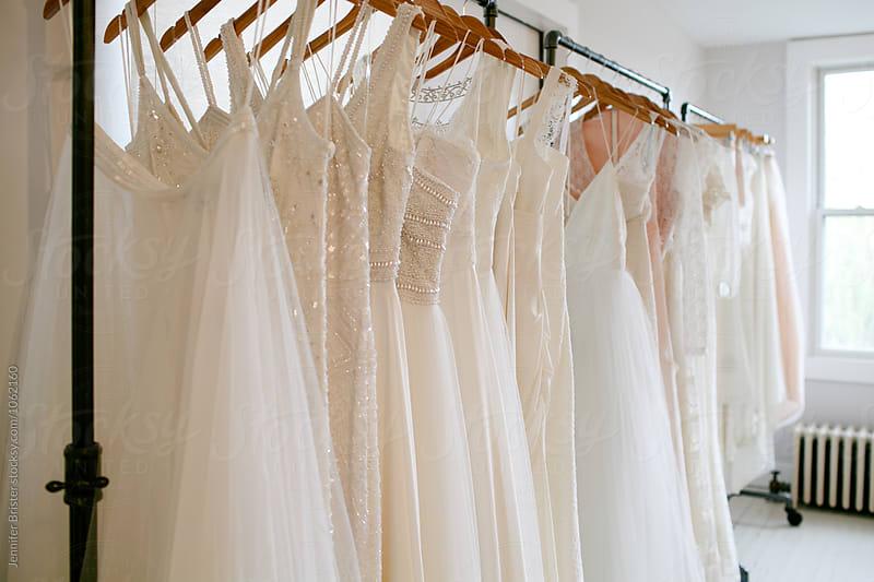 Rack of wedding dress by Jen Brister for Stocksy United
