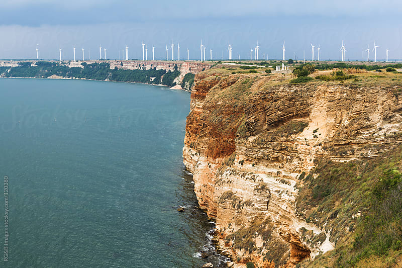 wind mills near sea  by RG&B Images for Stocksy United