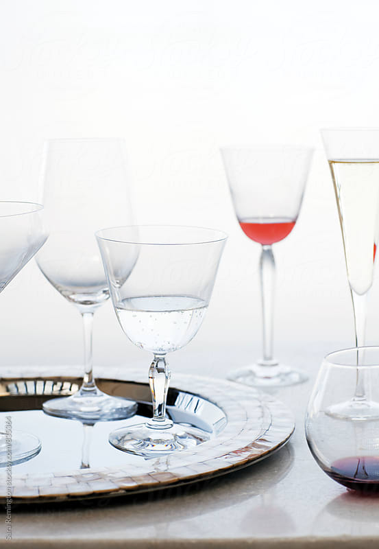 Wine Glasses on Tray by Sara Remington for Stocksy United