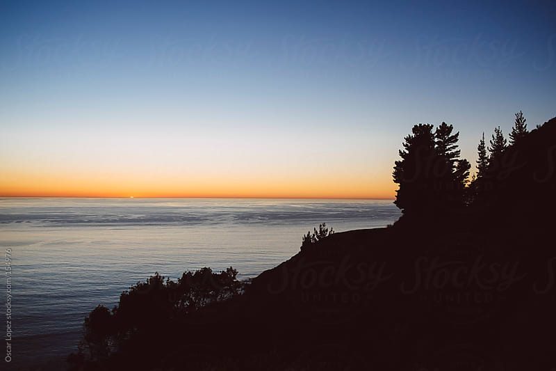 California coast during sunset by Oscar Lopez for Stocksy United