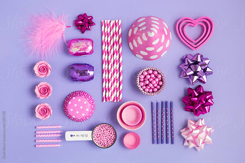 Collection of pink and purple objects for a birthday party by Ruth Black for Stocksy United