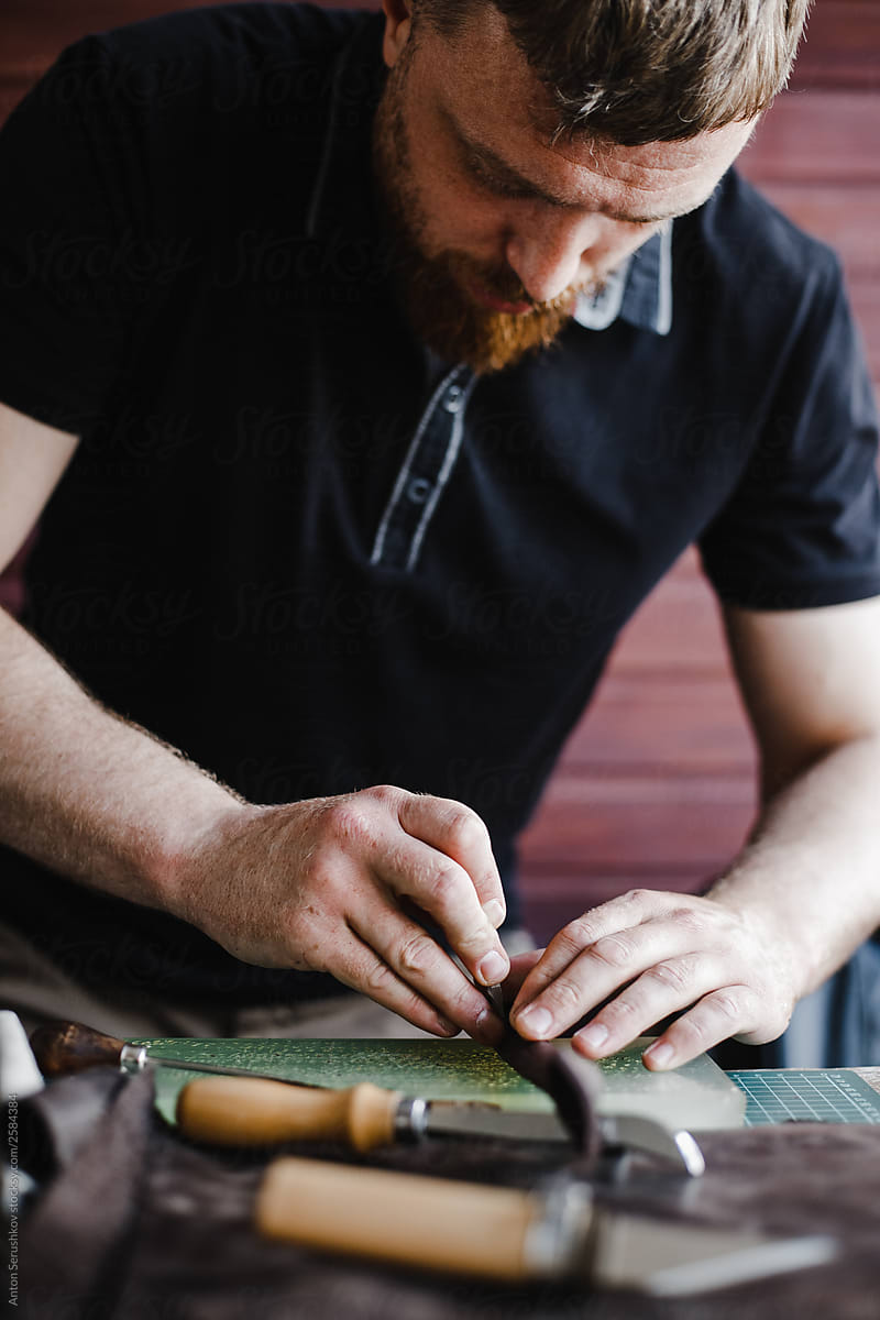 Stock Photo - Young Craftsman With Beard Makes A Product In His Workplace   Handmade