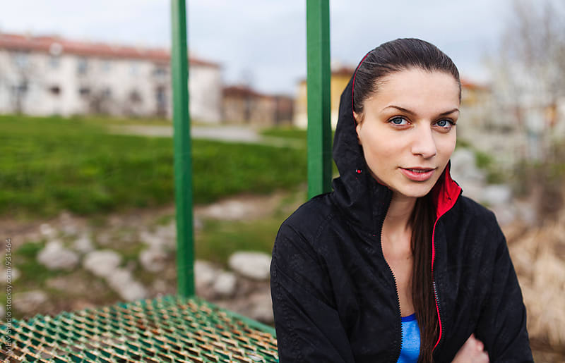 Portrait of a young sporty woman by MEM Studio for Stocksy United