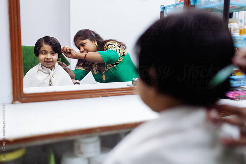 Little girl gets hair cut at beauty parlour by Saptak Ganguly for Stocksy United