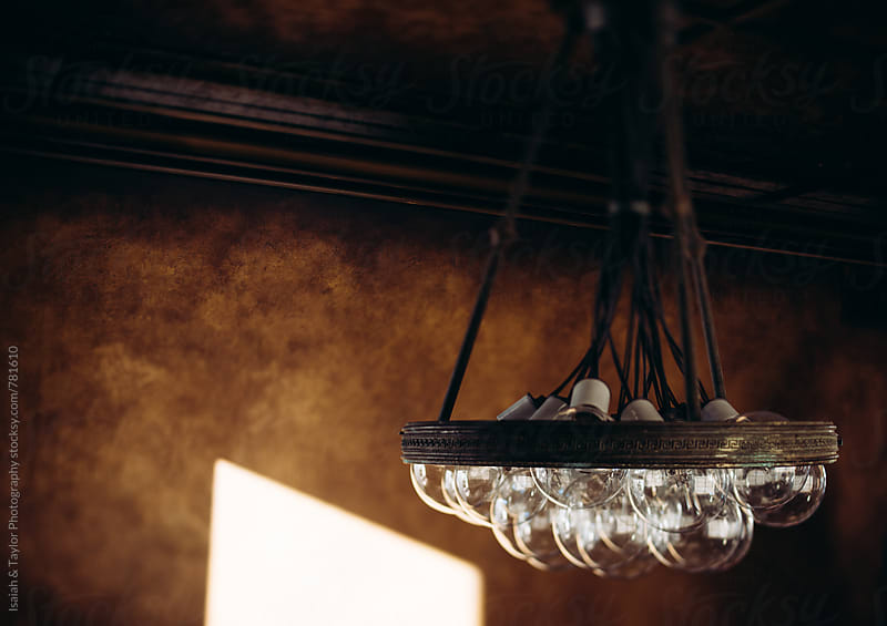 Light fixture indoors by Isaiah & Taylor Photography for Stocksy United