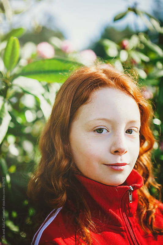 Confident redhead girl  by Rob and Julia Campbell for Stocksy United