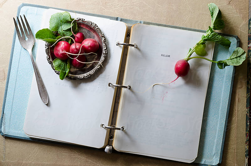 Recipe-book and radish by Trent Lanz for Stocksy United