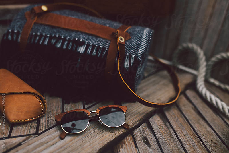 Sunglasses and Blanket by Kristian Lynae Irey for Stocksy United