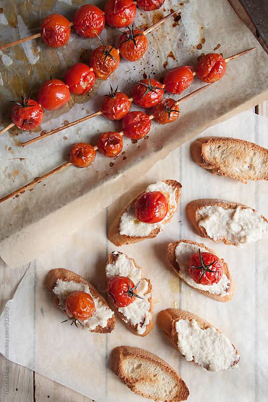 Roasted tomatoes crostini by Nataša Mandić for Stocksy United