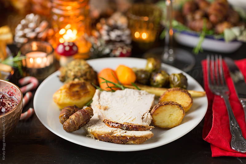 Festive roast turkey dinner for Christmas by Kirsty Begg for Stocksy United