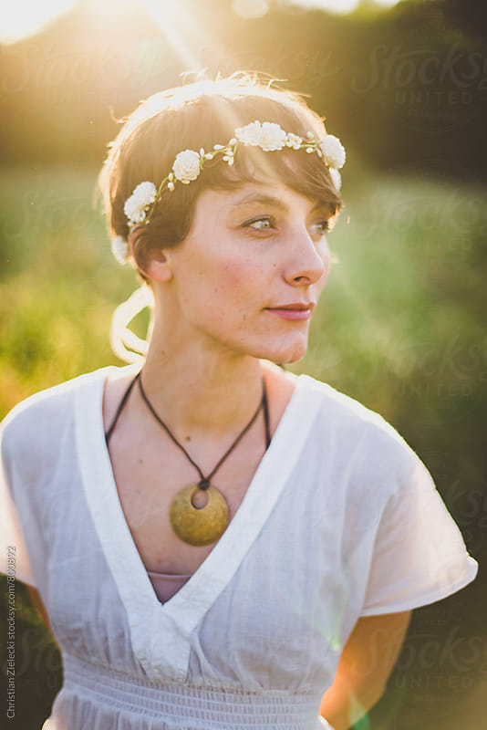 a bohemian bride in sunset light by Christian Zielecki for Stocksy United