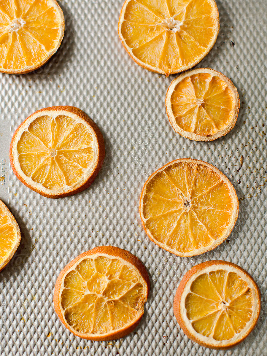 Making Dried Orange Slices For The Holidays Stocksy United