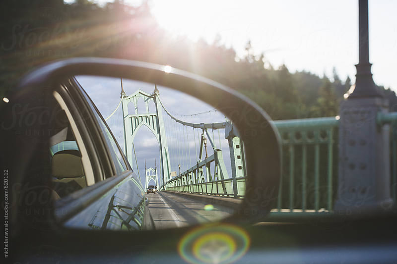 The St. Johns Bridge seen from the side mirror of the car by michela ravasio for Stocksy United