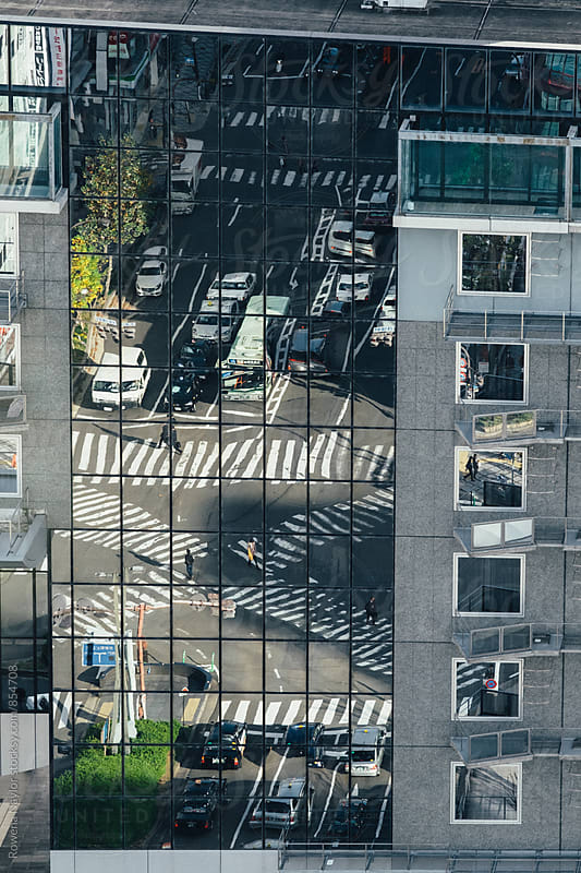 Refection of busy pedestrian crossing from above by Rowena Naylor for Stocksy United