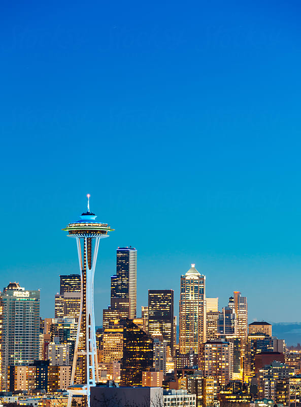 Quintessential vertical view of downtown Seattle with Space Needle at sunset by Mihael Blikshteyn for Stocksy United