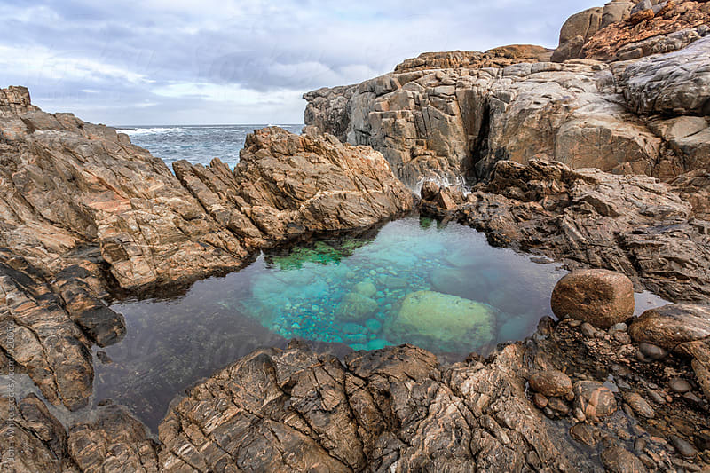 Rock pool by the sea. Australia. by John White for Stocksy United