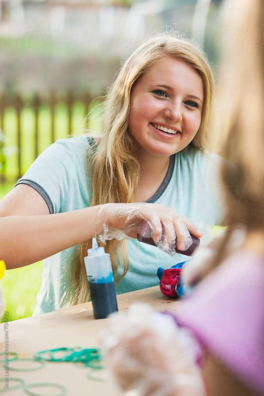 Tie Dye: Girl Friends Having Fun Doing Dyeing by Sean Locke for Stocksy United