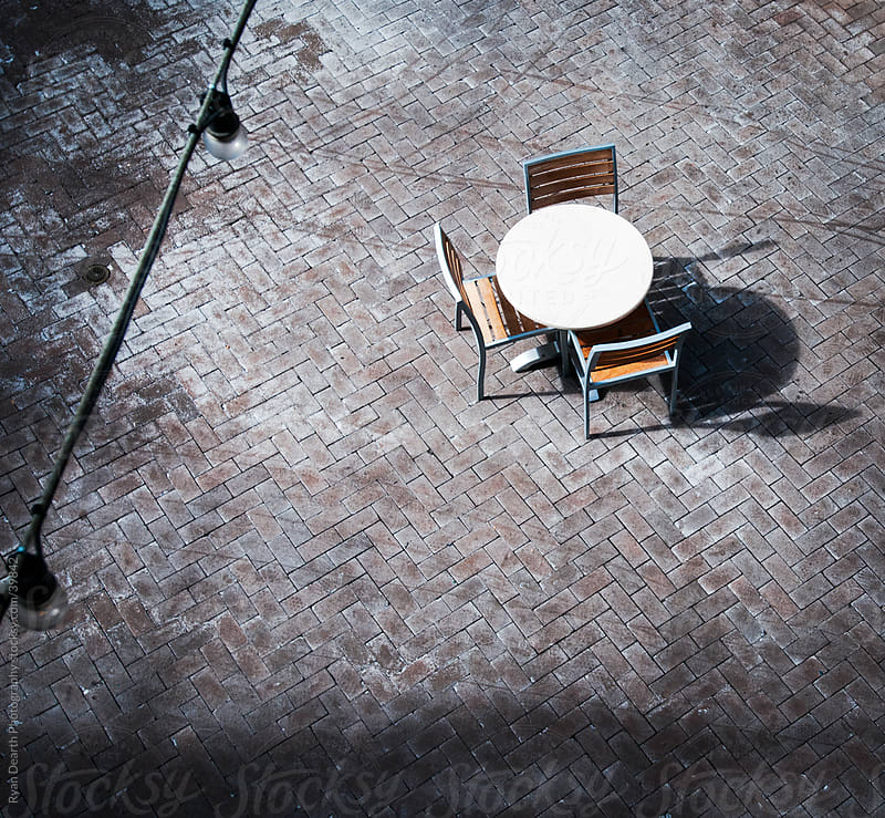 Lonely Table from Above by Ryan Dearth Photography for Stocksy United