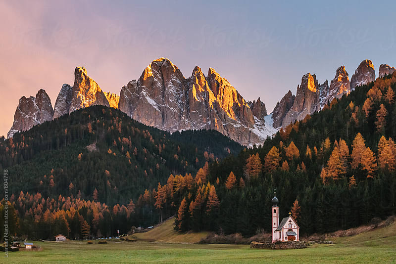 St Johann Church in Ranui in Villnoss, Val di funes, with the Geisler Mountain group in the back by Leander Nardin for Stocksy United