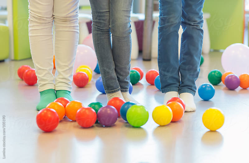 Kids' Legs and Colourful Balls by Lumina for Stocksy United